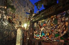 Philadelphia's Magic Gardens is a folk art environment, gallery space, and nonprofit organization that showcases the work of mosaicist Isaiah Zagar. Located at the site of Zagar's largest public mosaic installation, the Magic Gardens includes a fully mosaiced indoor gallery and a massive outdoor labyrinthine mosaic sculpture. The installation, primarily consisting of found objects and contributions from the community, covers half a city block with myriads of tile, texture, and color. A walk…