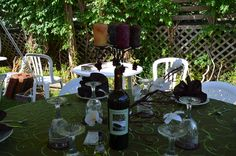 The wine bottle candelabra table decoration was part of the decor for a bridal shower with a wine theme. The wine bottle has a personalized label which included the bride and grooms name and wedding date with picture of the bride and groom. Also decorating the table was a small manzanita brach accented with flowers. In the wine bottle is a candelabra with scented candles all matching the wine theme.