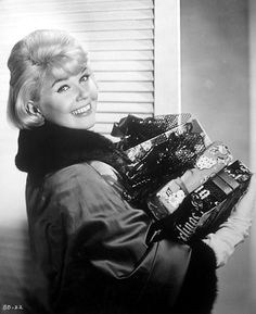 """Doris Day (born Doris Mary Ann Kappelhoff, April 3, 1924) is an American actress, singer, & animal rights activist. Day started her career as a big band singer in 1939, but only began to be noticed after her first hit recording, """"Sentimental Journey"""", in 1945. With a legendary Hollywood """"girl next door"""" image, Doris was a USA favourite. """"I like joy; I want to be joyous. I want to smile and I want to make people laugh. And that`s all I want. I like being happy. I want to make others happy."""""""