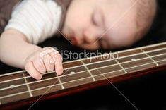 Newborn playing guitar Royalty Free Stock Photo