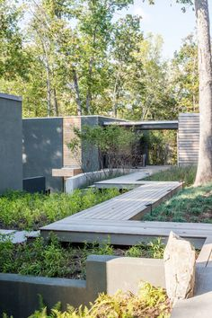 7 Landscaping Ideas For Your Front Yard // Include a bridge --- If you have multiple levels or a garden lower than the sidewalk, consider adding a bridge to create a unique entry way and keep people off your precious plants.
