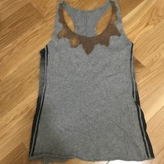 We The People gray racerback tank Gray tank with black striped detail on both sides. The neckline is outlined in a brown crochet. The item was intentionally faded on the brown neckline and on the sides in the black stripe. See pics for reference. We The People Tops Tank Tops