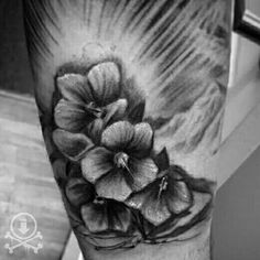 Lovely black and grey flowers added to a full sleeve tattoo by Kevin Soto (work in progress).  #12ozstudios #team12oz #tattoo #tattoos #tattooart #blackandgrey #flowers #realistictattoos #realism #tattoosformen #tattoosforwomen