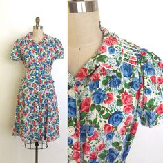 Absolutely darling early 40s day dress. Super rich blue and red rose print on cotton. Detailed with white ric rac. Fitted bodice and an a-line skirt with two patch pockets. Button up front. Material: cotton and ric rac  Bust: up to 40 Waist: 28 Hip: 40 Length: 41  Condition: Excellent. No flaws to note. Washed and ready to wear.  ••• for sneak peeks follow the shop on Instagram @rubymaerosevintage •••