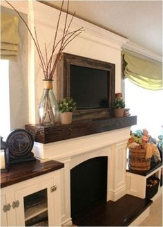 Wood mantel and white cabinets