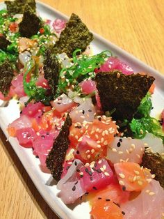 sashimi seaweed salad - trio of sashimi, crunchy and crispy seaweeds, b seasame and citrus dressing.