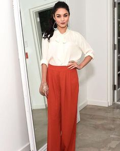 """The fab @vanessahudgens wearing these awesome burnt orange pleated pants and blouse by #Forever21. Perfect for the changing temps and both now available on Miner."