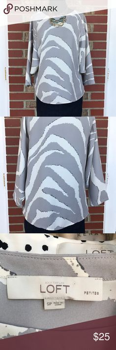 Loft Zebra Print Top Ivory and gray zebra print top by loft. Silky material and 3/4 sleeve top. A bit sheer so may need a top underneath. Perfect top for colored pants or simple jeans! Size petite small. LOFT Tops Blouses