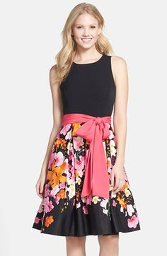Free shipping and returns on Eliza J Floral Print Faille Fit & Flare Dress at Nordstrom.com. A vibrant pink sash pops at the waist of a feminine fit-and-flare dress while cheerful blooms tumble down the printed, pleated skirt.