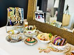 20 Great Jewelry Storage and Organization Ideas. The tea cups are adorable! Fun way of displaying my old heirlooms and jewelry.
