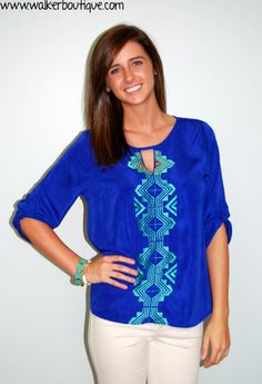 Our model is 5'6 and is wearing a medium in this beautiful top. The colors are even more vibrant in person!