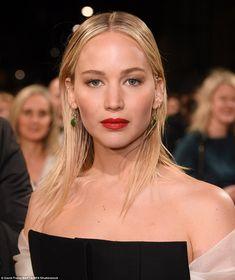 Striking: She added a slick of red lipstick to offset the black garment... #jenniferlawrence
