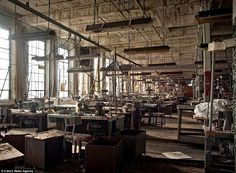 Where time stands still: An abandoned clothing factory still with all the machinery on tables as if it were left yesterday. By Matthew Christopher