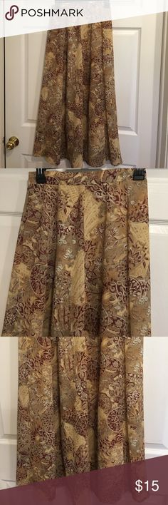 Casual Corner Fall Skirt Casual Corner fall skirt. Never worn. Lined. 100% polyester size 4. Burgundy, tan and brown color. Waist 26. Length 35 1/2 Casual Corner Skirts
