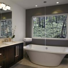 wall mount for free standing tub | Marfil vanity with rectangular under mount sinks, free-standing tub ...