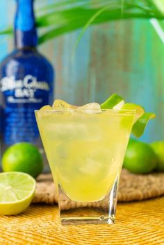 Luck emerald is an easy three ingredient cocktail recipe. It uses melon liqueur and pineapple juice. Just pour ingredients into a glass filled with ice and garnish with a fresh lime. Enjoy this refreshing drink by the pool or at the beach. Click here for the full website. #bluechairbay #BCBHappyHour #coconutrum #rumcocktail #beachcocktail #coconut #rum #pineapplejuice #melonliqueur
