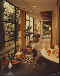 Beautiful technicolor photo of the Eames House in the 1950s