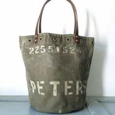 Pillow inspiration - stencil last name on canvas to look like it was upcycled from a vintage military bag.