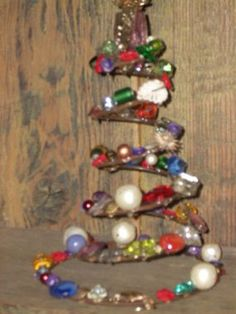 Cute jeweled bed springs make great tree toppers, wine bottle decorations or as it is a Christmas tree.  Use better beads than the ones shown here.