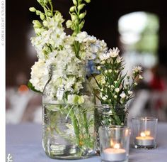 Mix matched jars of flowers with tealights