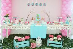 Pink backdrop with tier of balloons on each side. Add Butterfly garland to back drop