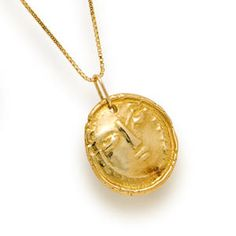 An eighteen karat gold pendant, Pablo Picasso, Madoura Emprente  depicting a womans face, suspended from a delicate eighteen karat gold chain; signed Picasso, Madoura, France; gross weight approximately: 45.5 grams; length of pendant: 1 1/4in.;