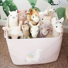 There's nothing quite like a basketful of llamas to make you break out in a smile. I'm honestly amazed that my friends and family were able to find so many llama things for Bella's room! I had no idea when I picked her nursery theme of llamas and cacti th