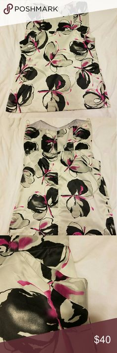 NWT SAGE MINI Never been worn dress with pockets. Has a silk feel but is 100% polyester. Sweetheart shaped neckline. Dresses Mini