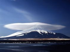 A unusual cloud formation above Mount Ararat, a dormant volcano in Turkey's Ağrı Province near the borders of Iran and Armenia. It consists of two peaks (Greater Ararat and Lesser Ararat), the taller rising almost 17,000 feet in elevation making it the tallest in the country.