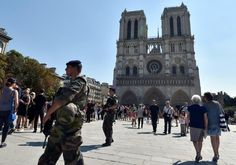 French police shot and arrested a woman suspected of leaving a car containing six gas canisters outside Notre Dame