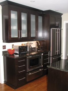 Retro cabinets stained espresso dark finish. - Check out the before and after photos!  Gorgeous reno!