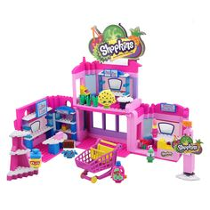 Now you can build the world of the cutest, most-collectible characters with the Shopkins Kinstructions Deluxe Town Center Set! This adorable set comes with a buildable Two-Level Supermarket and 6 buildable figures! Get a snack at the Sweet Shop, a make over at the Beauty Boutique or shop the Mini-Mart! Build, Shop and Kinstruct your Shopkins world!<br>Includes: 410 Pieces, 6 Buildable Figures, Deluxe Set and Accessories<br>