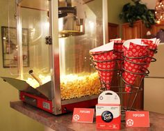 Popcorn Holders  If you're tired of keeping the night classy and want to loosen up a bit, kick back with your popcorn in these printable cones by Glue Dots.