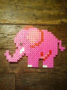 Pink elephant perler beads by Dorothea Hama Beads Patterns, Beading Patterns, Fuse Beads, Perler Beads, Iron Beads, Melting Beads, Elephant Pattern, Beaded Animals, How To Make Beads