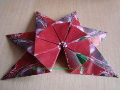 Zoals belooft hier de stap-voor-stap foto's van de groene thee-ster. Dit keer in het rood. Voor 1 ster heb je 8 vierkante papiertjes no...