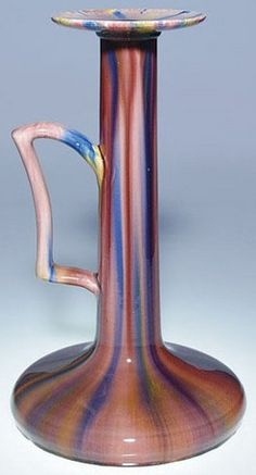 """lighting, France, A Massier trumpet-shaped candleholder done in shades of rose, purple and yellow under a clear high glaze. Impressed ClementMassier Golfe Juan"""" on the bottom. Circa 1870-1915"""