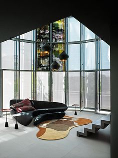 Boxing Life by UdA – Architetti Associati  TOM dixon lamp. and a nice couch...awesome.irregular shape area rug,great.