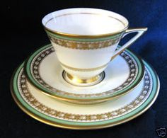 Doulton deco: unnamed tea trio, V1700, Rd 776716, c1935 (pattern). Green and gold gilt geometric banded design with gold gilt highlights and trim. Rare!