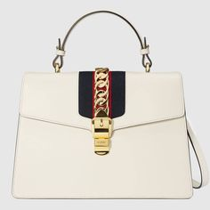13c21815626 Shop the Sylvie medium top handle bag by Gucci. Our Sylvie bag in a  beautiful