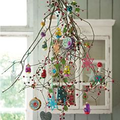 branches with colorful ornaments and pompoms