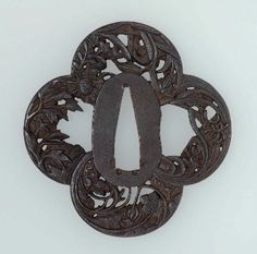 Tsuba with design of tiger-lily, chrysanthemum, Chinese bellflower and other blossoms