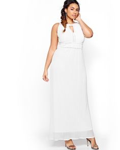 AVAILABLE ONLINE ONLY. Be confident when you say yes on your wedding day dressed in a magical plus size wedding dress that will transport you to another era with its beaded details, its flattering empire waist, its halter neckline and keyhole cutout, and its rich fabric. Your fiancé won