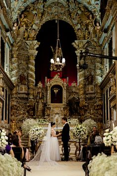 Stunning! That church is so beautiful - it's breathtaking! The mass of simple white flowers is the perfect touch to enhance this gorgeous church, not detract from it. Wow...