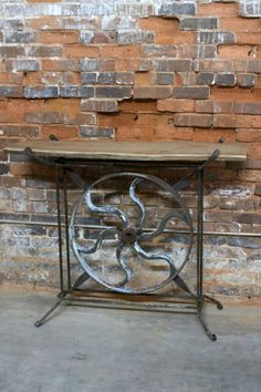 This stunning, one of a kind industrial table has an iron base made from an old gear and has an oak wood top. Its a perfect bar, desk, entryway