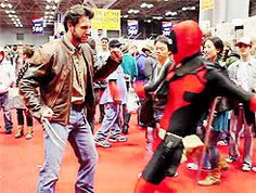 Hysterical gifs of Deadpool having fun with other cosplayers at Comic-Con