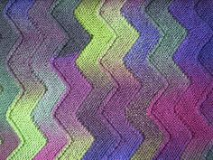 Worked on just ten stitches, these garter stitch zigzag strips are joined as you go so there is no sewing up. This technique can be used to make blankets or scarves and works with any yarn and needles. The strips could also be knitted in different yarns making it a good pattern for using up oddments.