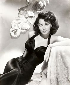 Ava Gardner in a black dress with sweetheart neckline and bold shoulder straps c. mid to late 1940s.