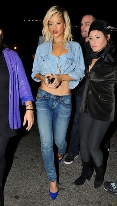 Rihanna signs autographs for her fans as she leaves Milk Studios late at night after a photo shoot.