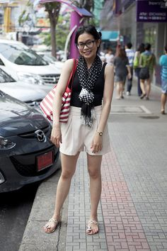 Kavita Binkaima, student. Scarf from Central Lad Prao shopping center, shoes from Union Mall, shorts from Siam Square.