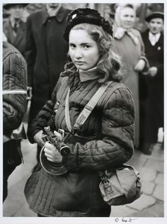 historyinpictures:  Hungarian girl in the revolution, Budapest...